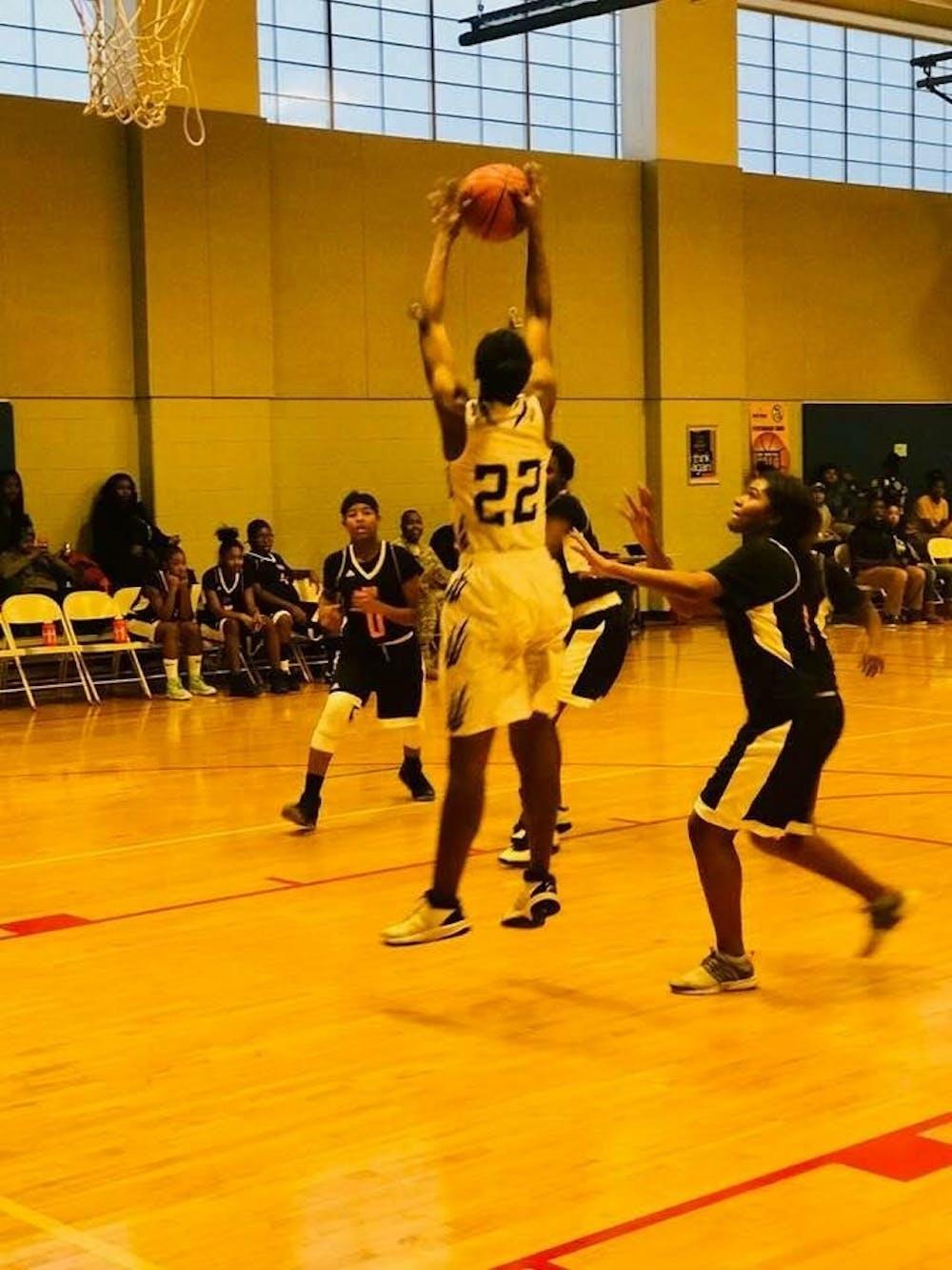 <p>Forward center Sancia Johnson grabs the rebound.</p>