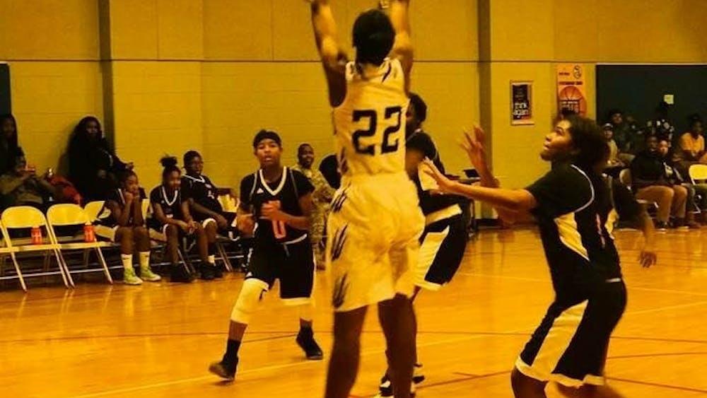 Forward center Sancia Johnson grabs the rebound.