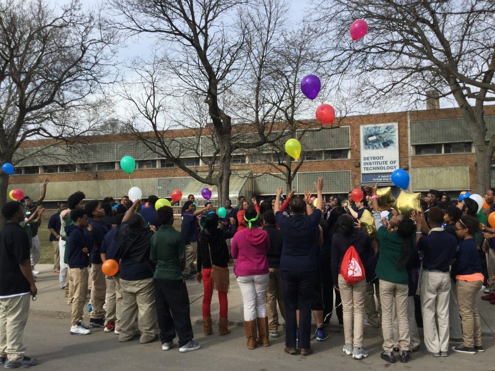 DIT students and staff release balloons at the end of a Mar. 9th gathering to honor school social worker Deborah Cahee who died on Mar. 2.