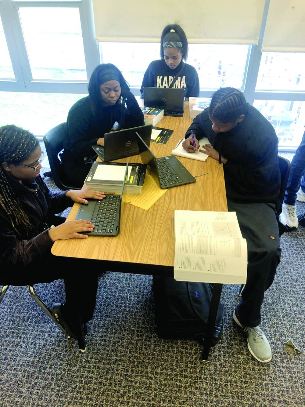 <p>Kenya Johnson, Shantel Morrow, Mar'Tya Remson and Victor Williams work on SAT prep in Ms. Johnson's class.</p>