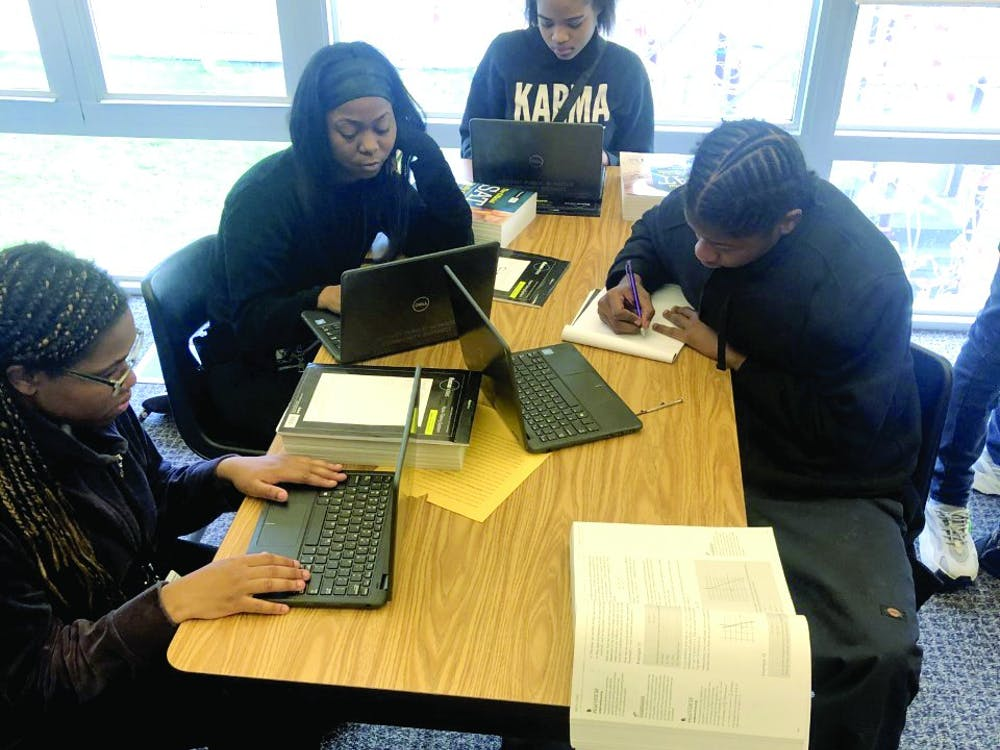 Kenya Johnson, Shantel Morrow, Mar'Tya Remson and Victor Williams work on SAT prep in Ms. Johnson's class.