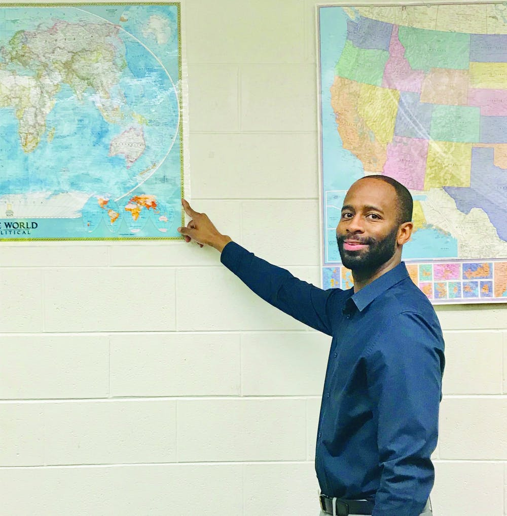 <p>History teacher Sirian Woods Woods provokes students to imagine and learn American and world history through visual aids and technology.</p>