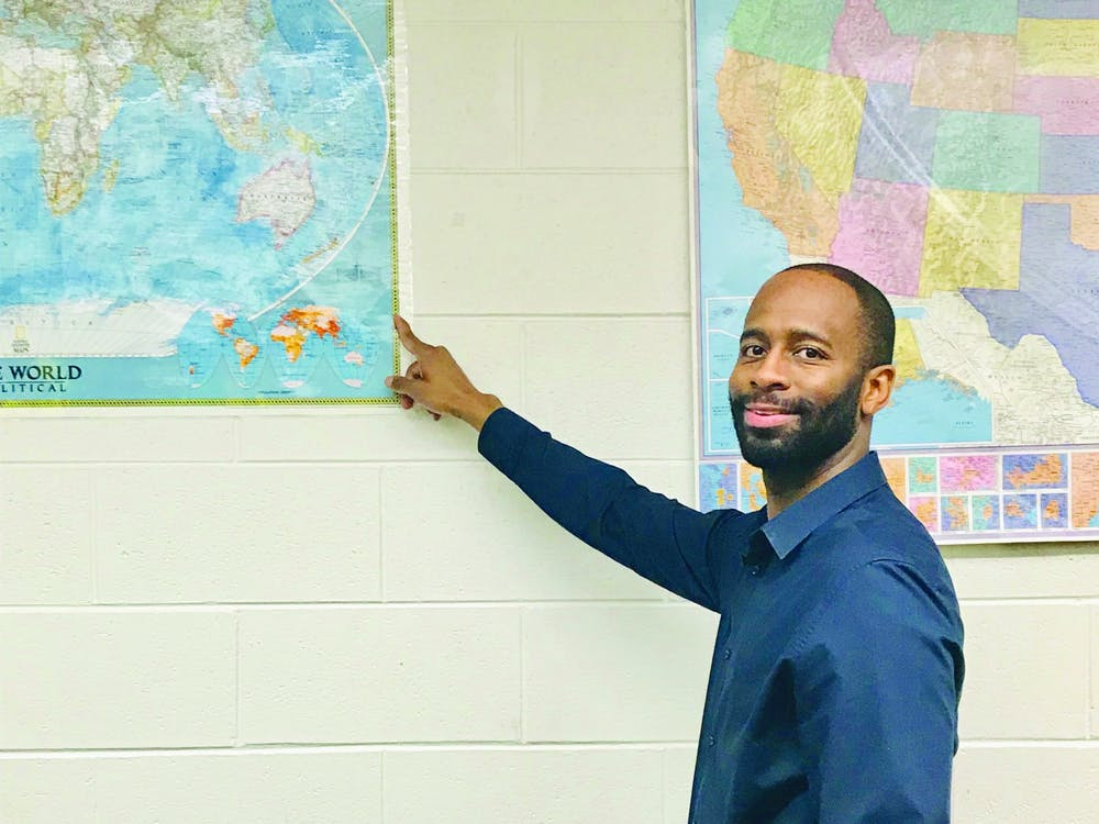 History teacher Sirian Woods Woods provokes students to imagine and learn American and world history through visual aids and technology.