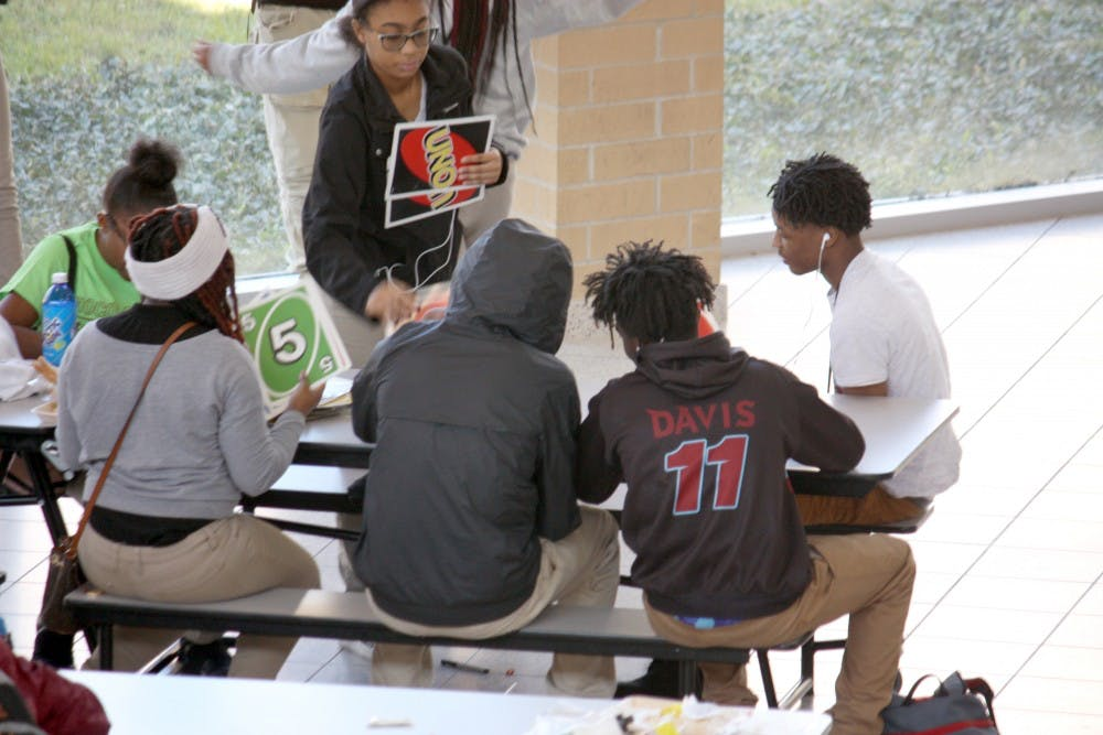 <p>Students play giant Uno while they eat lunch in the Mumford cafeteria on Oct. 25. Giant Jenga and giant Connect 4 are also popular.&nbsp;</p>
