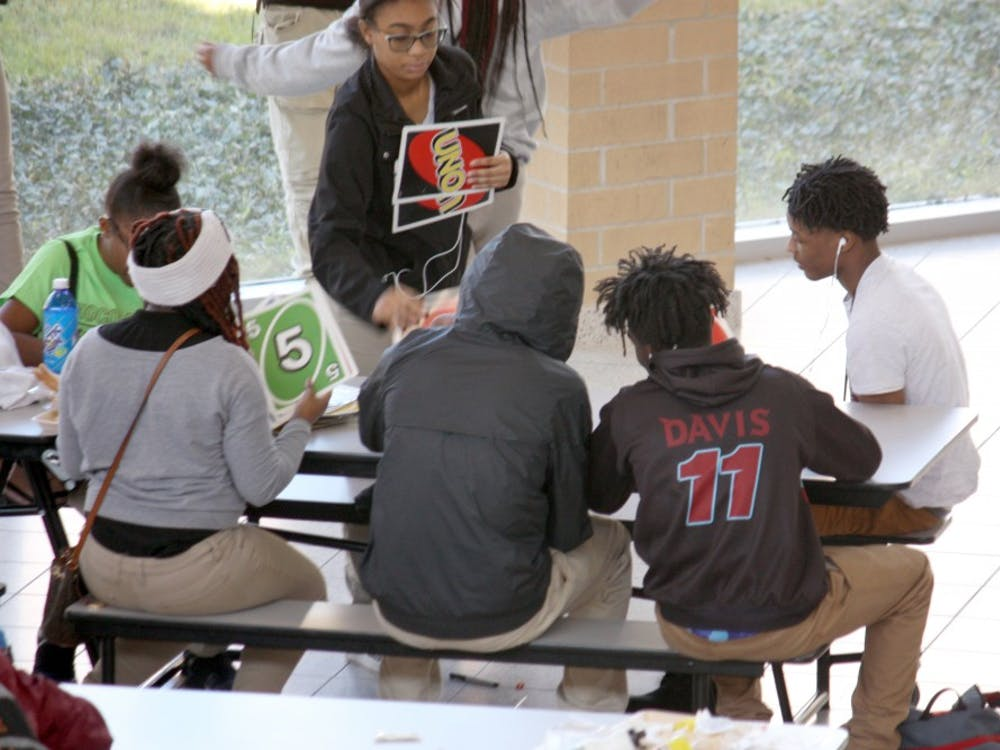 Students play giant Uno while they eat lunch in the Mumford cafeteria on Oct. 25. Giant Jenga and giant Connect 4 are also popular.