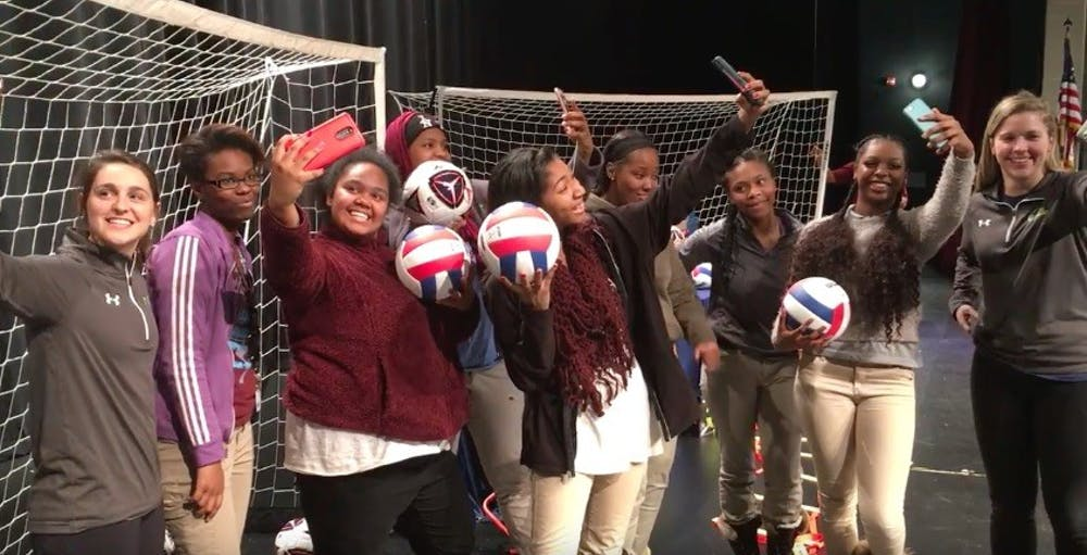 <p>Mumford athletes and&nbsp;representatives from Good Sports clown&nbsp;around on the Mumford stage&nbsp;with some of the sports equipment Good Sports brought to Mumford on Feb. 16.</p>