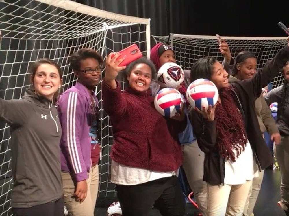 Mumford athletes and representatives from Good Sports clown around on the Mumford stage with some of the sports equipment Good Sports brought to Mumford on Feb. 16.