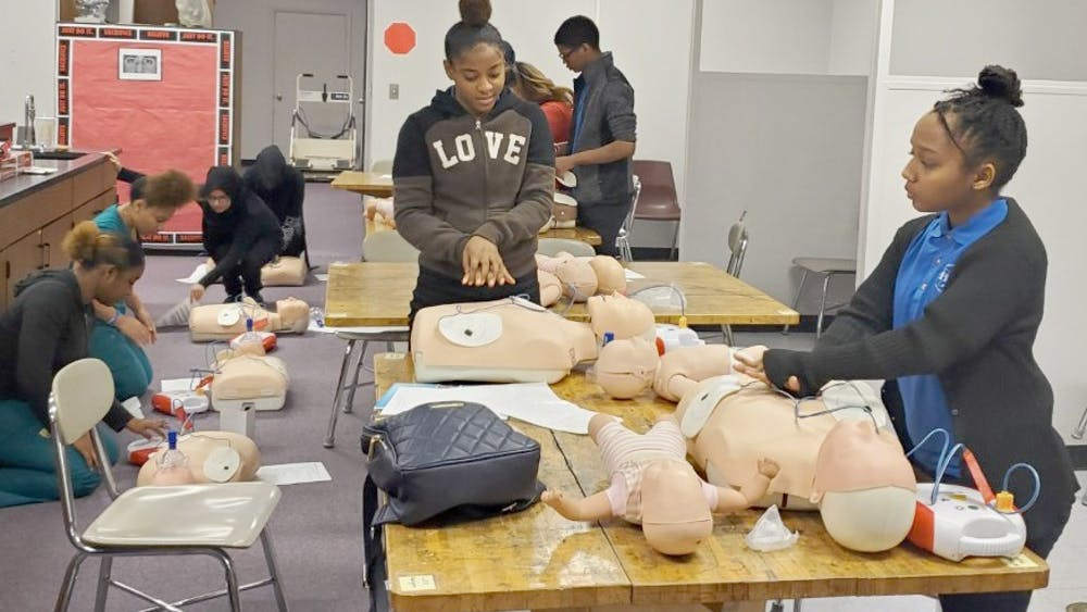 Shyla Hudson and Symphony Isabelle practice CPR on mannequins along with other students. Photo courtesy of Gwendolyn Mia.