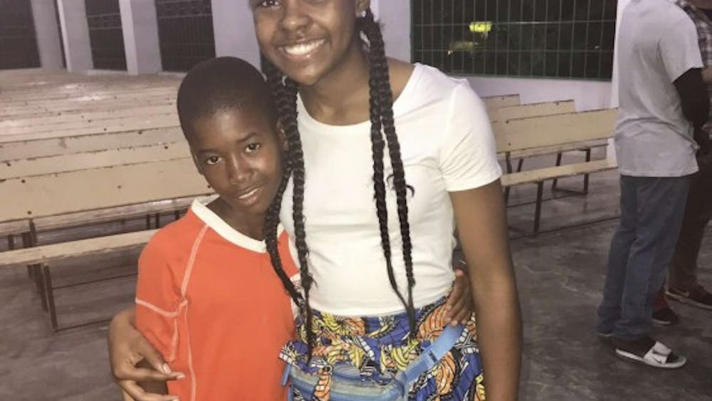 Sade' Ried and village boy attending Mission of Hope's Church.Photo Credit: Aaron Donaghy Avondale High School teacher