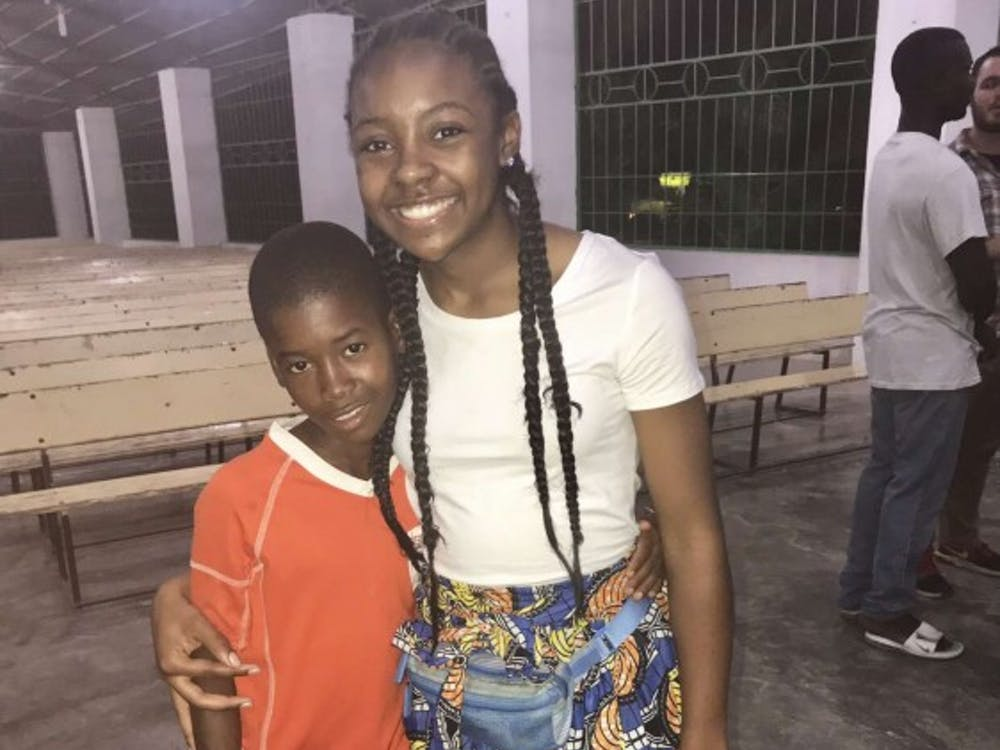 Sade' Ried and village boy attending Mission of Hope's Church. Photo Credit: Aaron Donaghy Avondale High School teacher