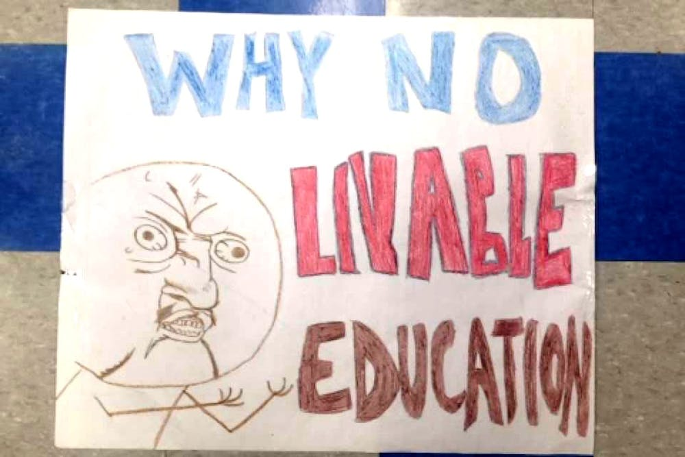 <p>Detroit International Academy senior Hawa Rahman created protest signs, including this one. She said&nbsp;does not believe officials are applying enough effort towards fixing the facilities.</p>