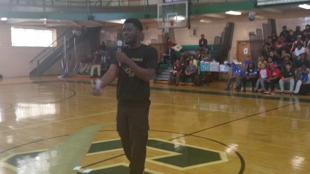 Slam poet Abdoulaye Doumbouya performs at the College Decision Day in the Cody gym on May 14. The DIT senior will go to the US Army on July 18.