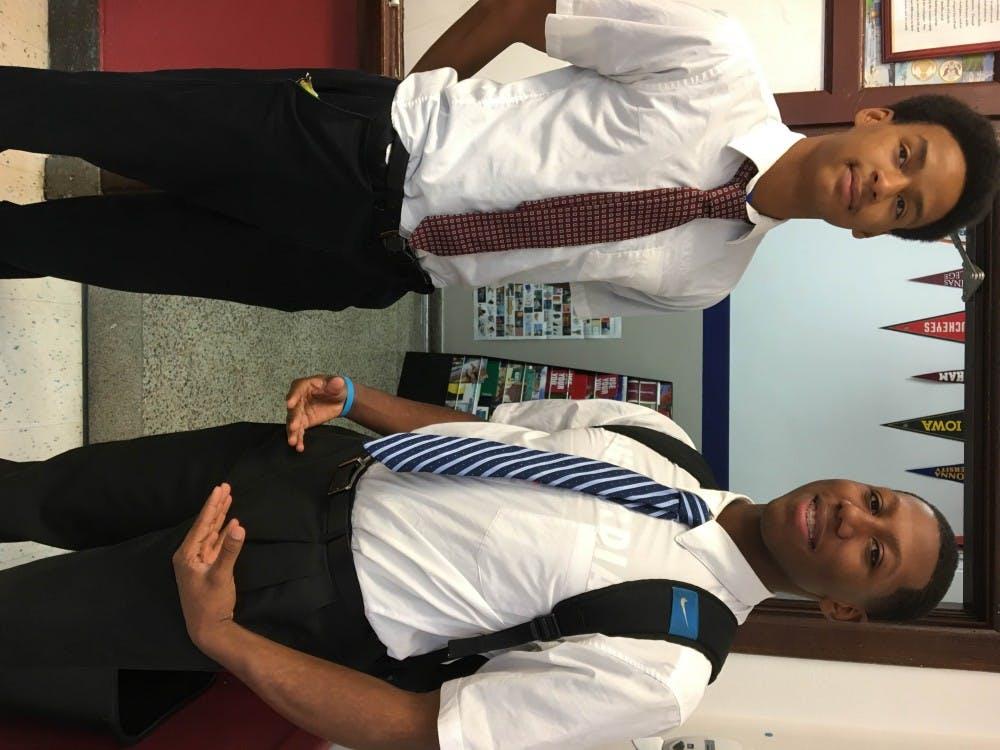 Cristo Rey studentsShaun Pruitt and Zion Stone wear their uniforms: clean-cut button downs and black slacks.
