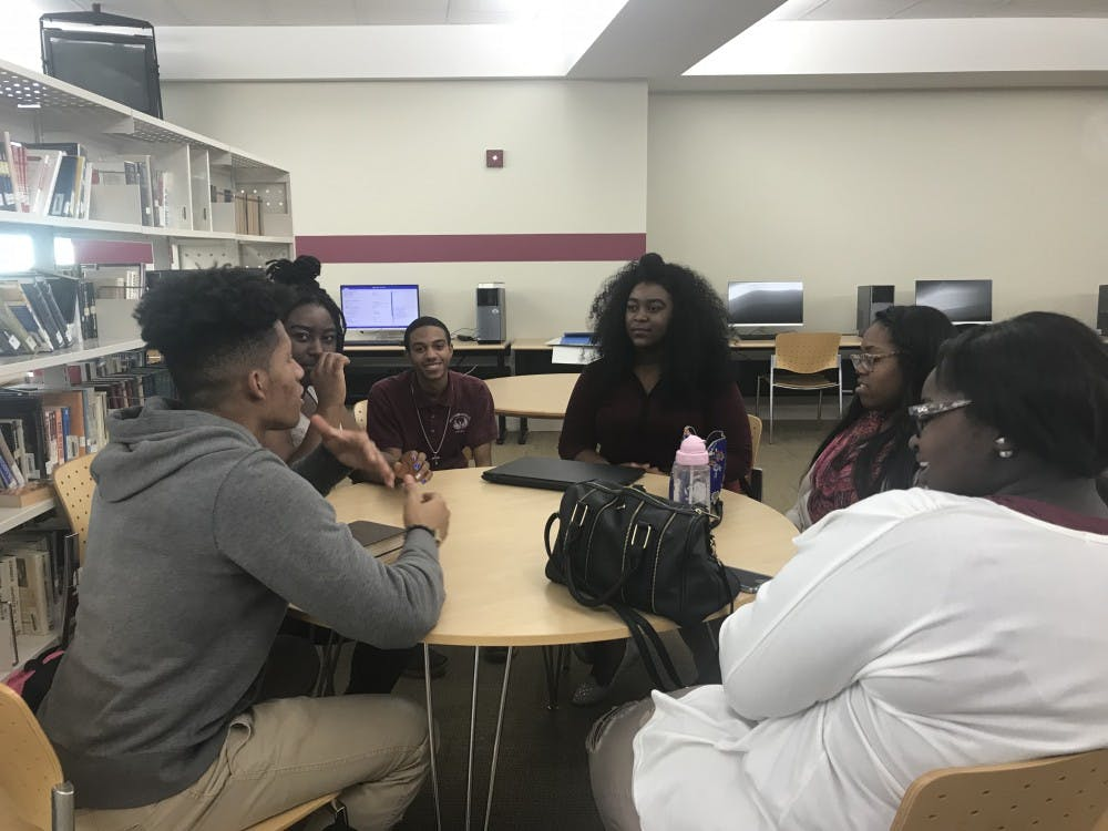<p>S.A.L.T members gather around table to discuss topics regarding race, politics and religion. </p>
