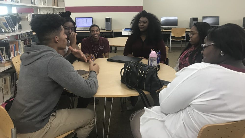 S.A.L.T members gather around table to discuss topics regarding race, politics and religion.