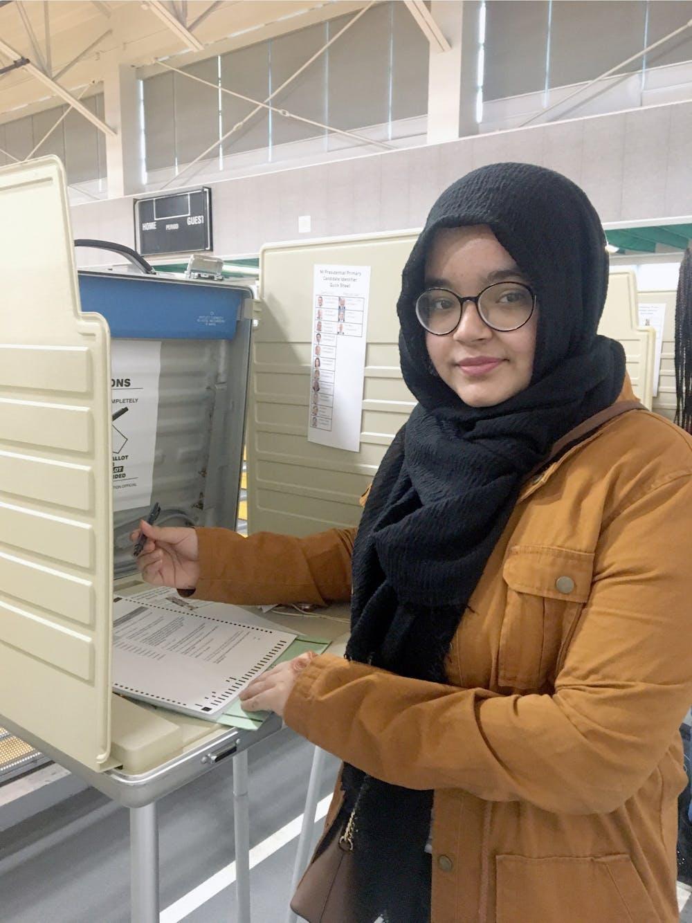 <p>Senior Sadia Rahman casts her vote. Photo by Naja Johnson.</p>