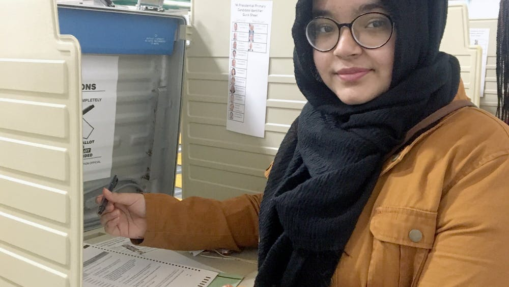 Senior Sadia Rahman casts her vote. Photo by Naja Johnson.