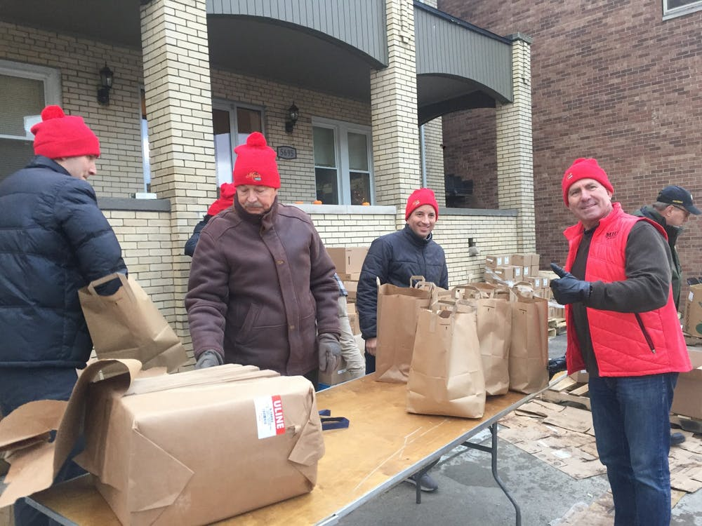 <p>Volunteers package food, cleaning, and health items. Photo by Lizbeth Morales.</p>