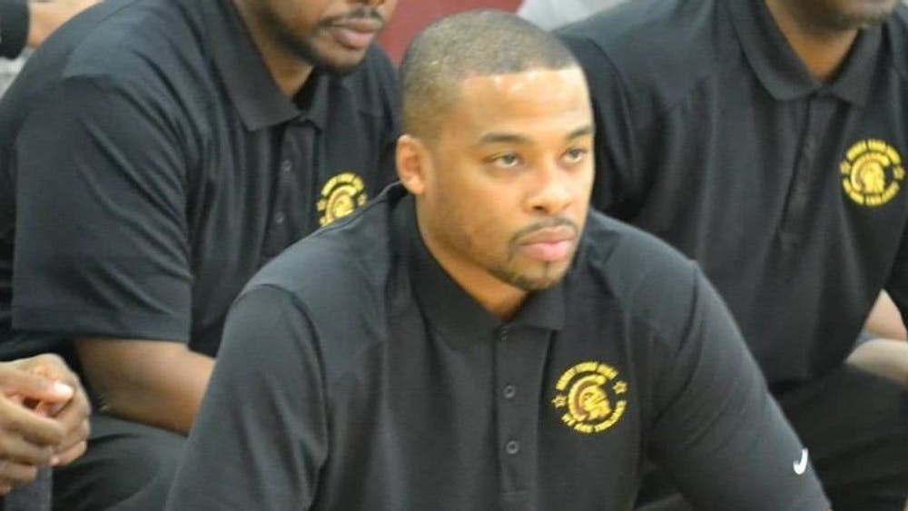 Henry Ford Dean of Students Kenneth Flowers is also the school's head boys basketball coach and athletics director.