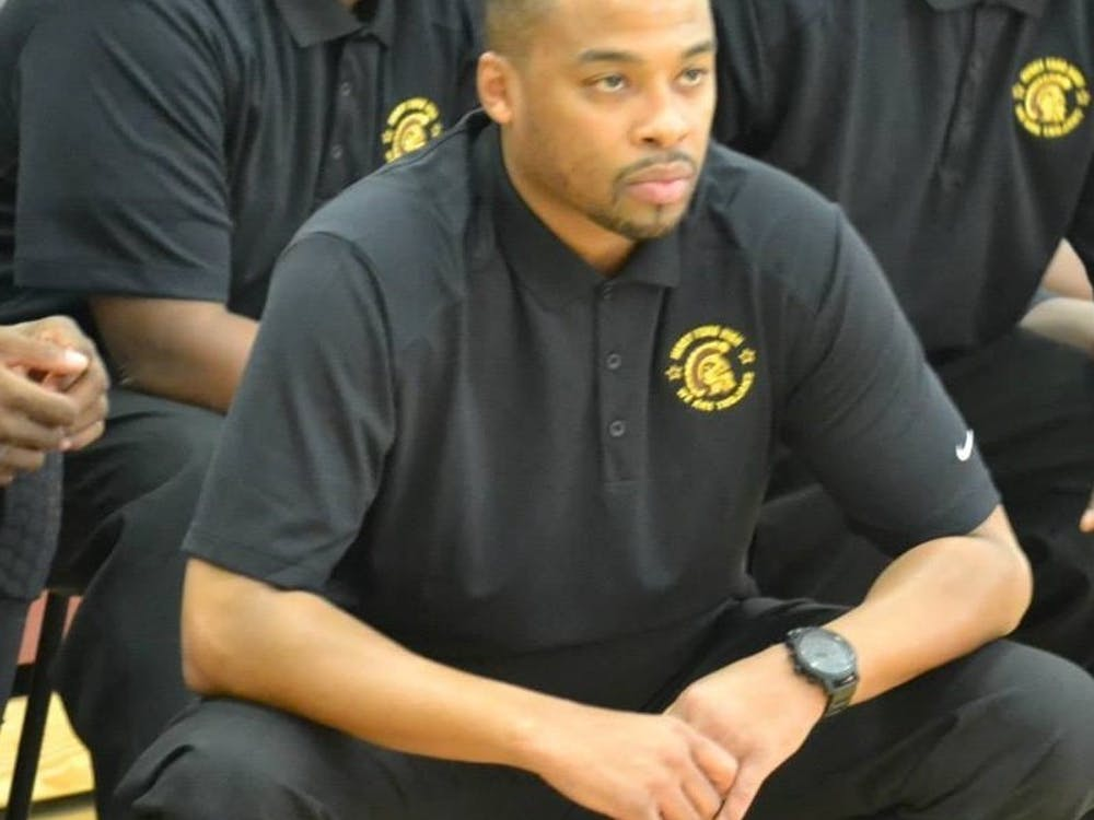 Henry Ford Dean of StudentsKenneth Flowers is also the school'shead boys basketball coach and athletics director.