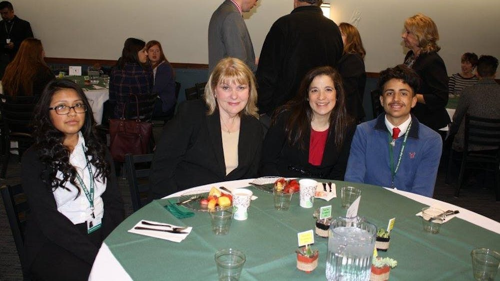 Landon Borrego, far right, with work partners at the 2017 Corporate Work Study Partner Appreciation Breakfast