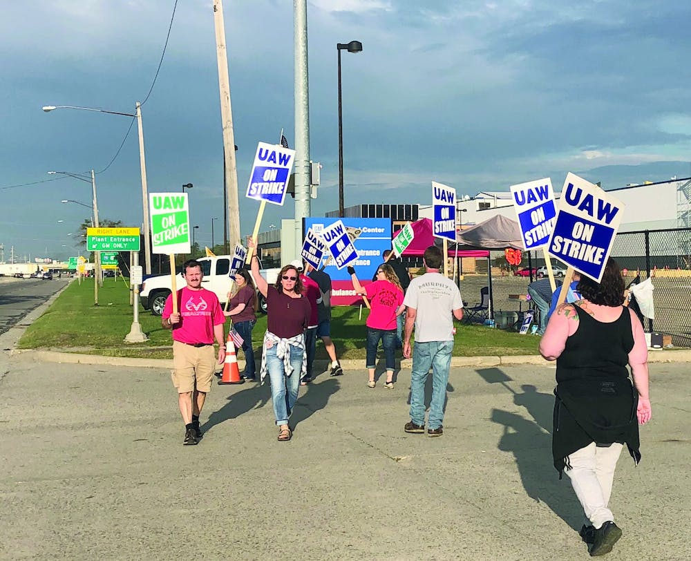 <p>UAW workers outside Flint Assembly. Photo by Michael Martinez, Automotive News.</p>