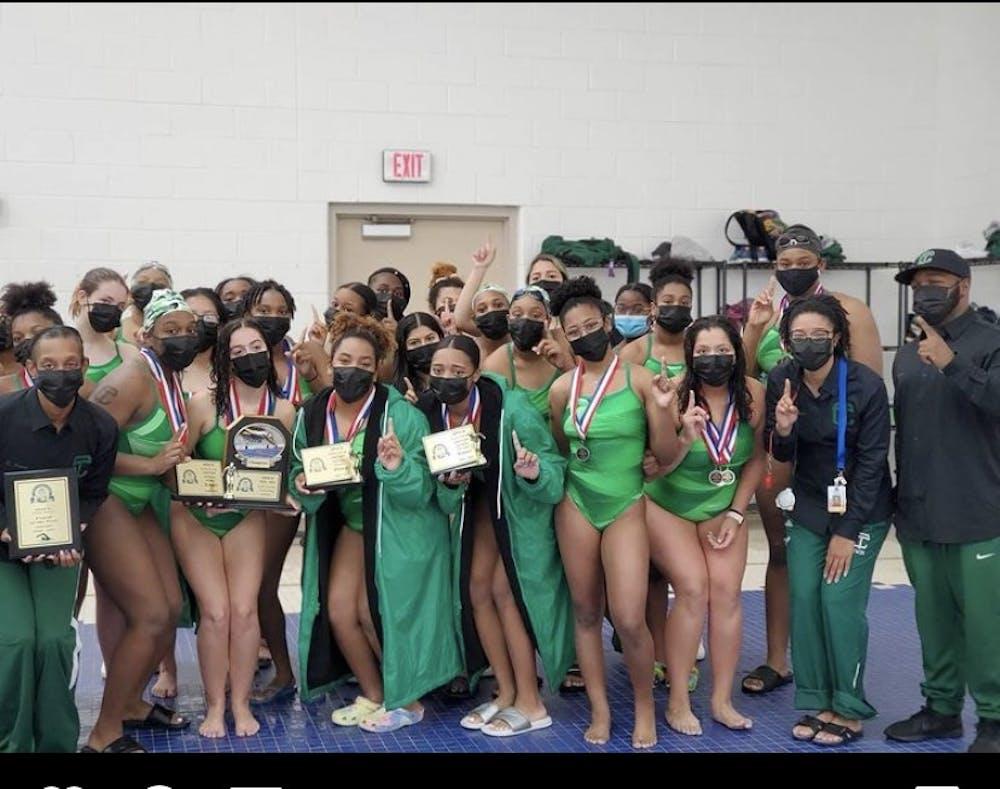 <p>The Cass Tech girls swim team celebrates its league championship.</p>
