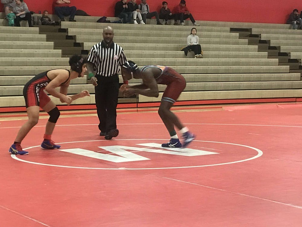 <p>Michael Watson squares off against an opponent at a match on Feb. 8 at Melvindale H.S.</p>
