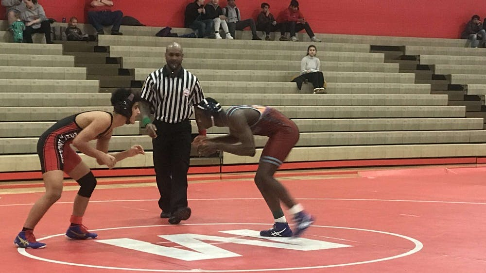 Michael Watson squares off against an opponent at a match on Feb. 8 at Melvindale H.S.