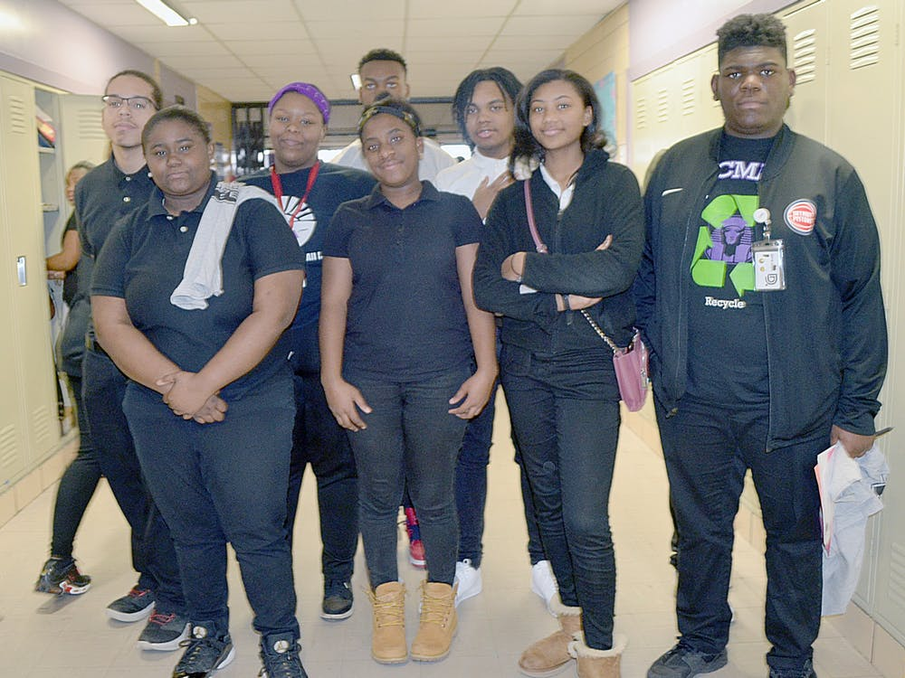 Communication and Media Arts robotics team members pose for a group photo.