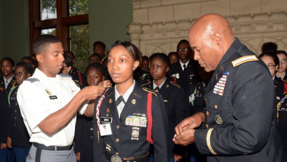 Core Commander Lawerence Shepherd (right) honors Lauryen Smith alongside Colonel George Pettigrew (left), Director of Army Instruction in Detroit Public Schools