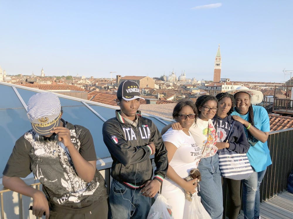 <p>Benjamin Carson High School students enjoy the view of a rooftop in Venice.</p>