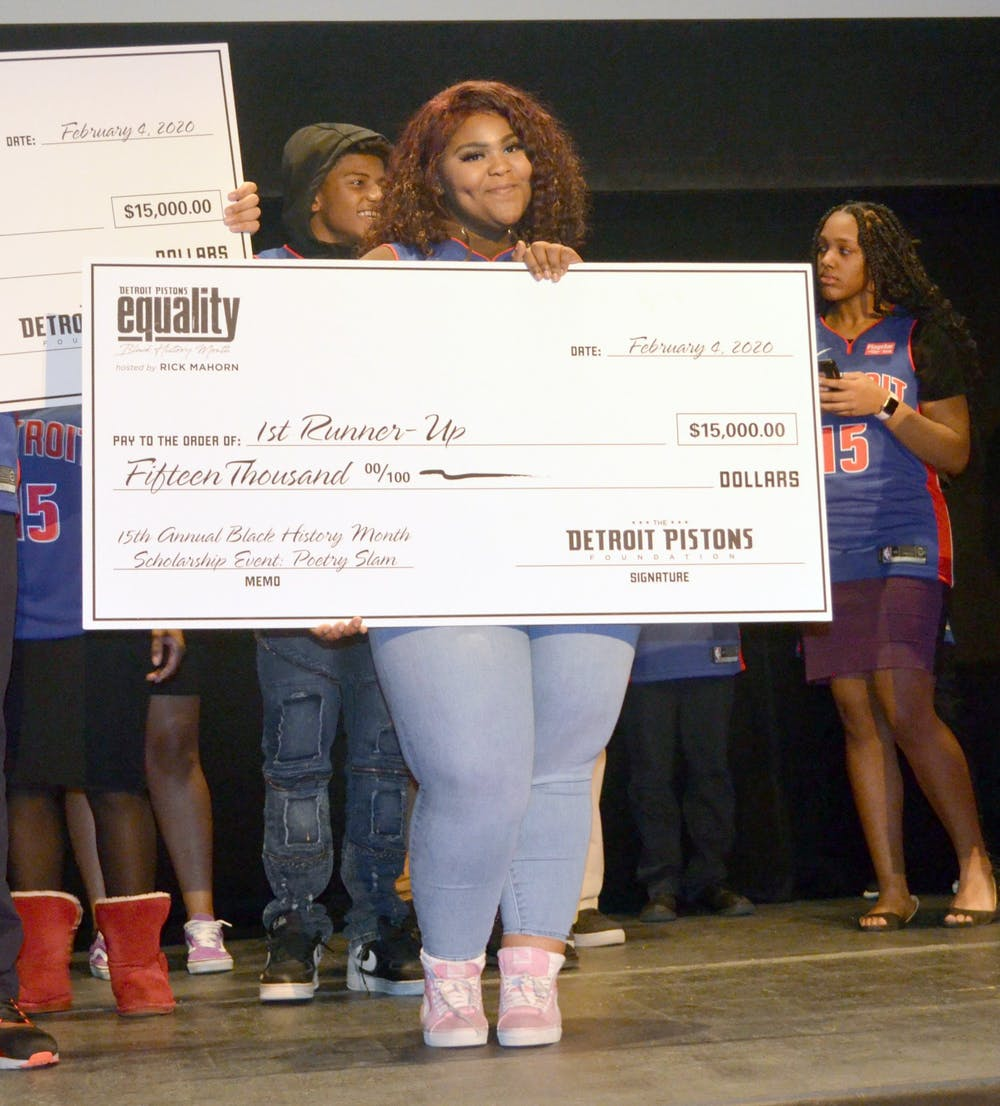 <p>Imari Deadrick holds up second place check for the scholarship. Photo by Tyler Parker.</p>