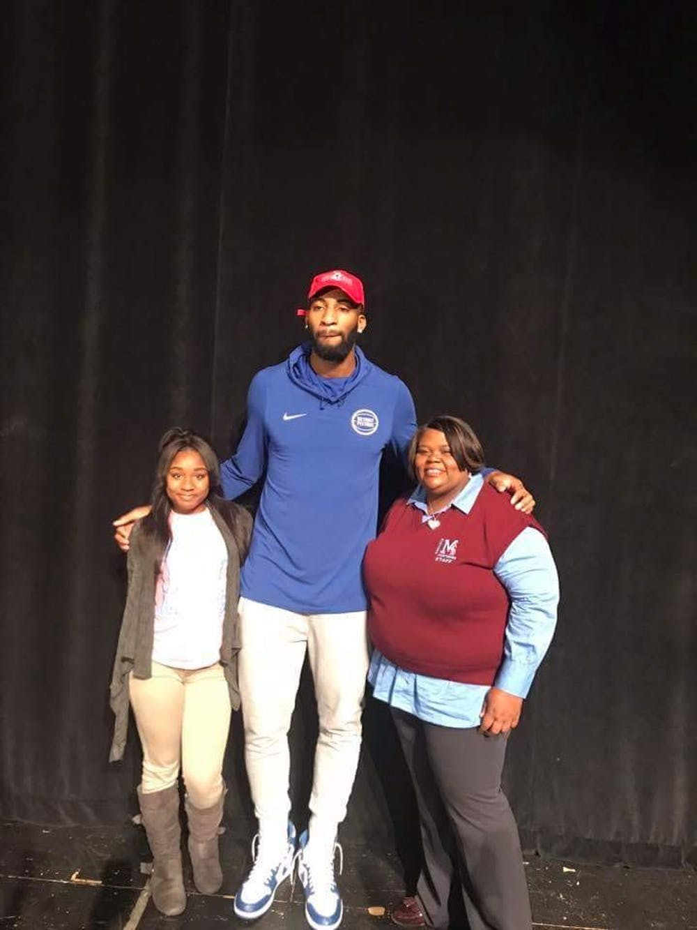 <p>(Staff Photo/Mustang Voice) Detroit Piston Andre Drummond poses with senior Ebony Norwood and Mumford H.S. Principal Angela Prince on Oct. 24&nbsp;after awarding the school with prizes for a winning video produced by Norwood.&nbsp;</p>