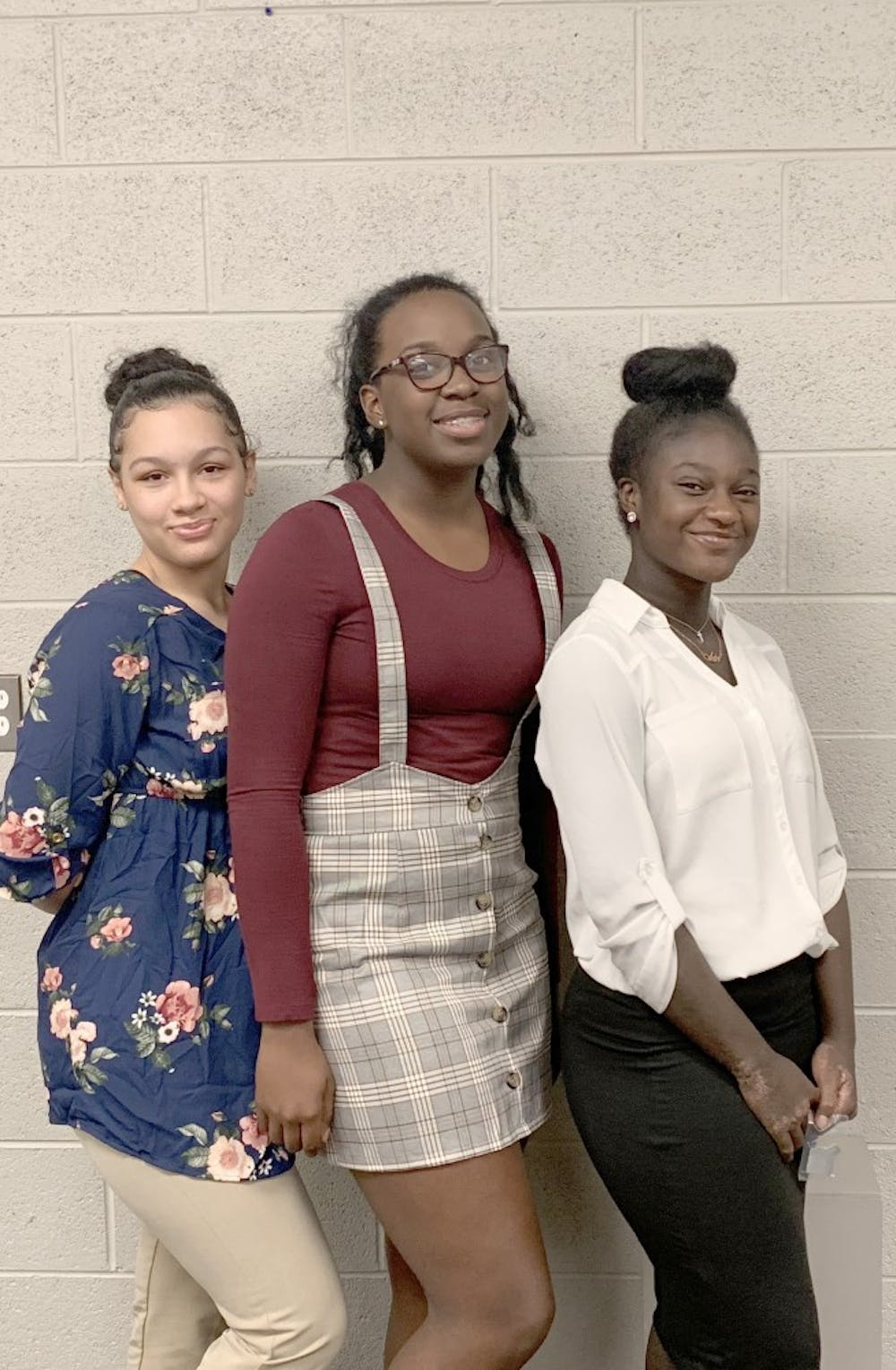 <p>Girls volleyball members Alicia Stanley, Paige Love, and Adriana Dent all received Catholic League Honors this year.</p>