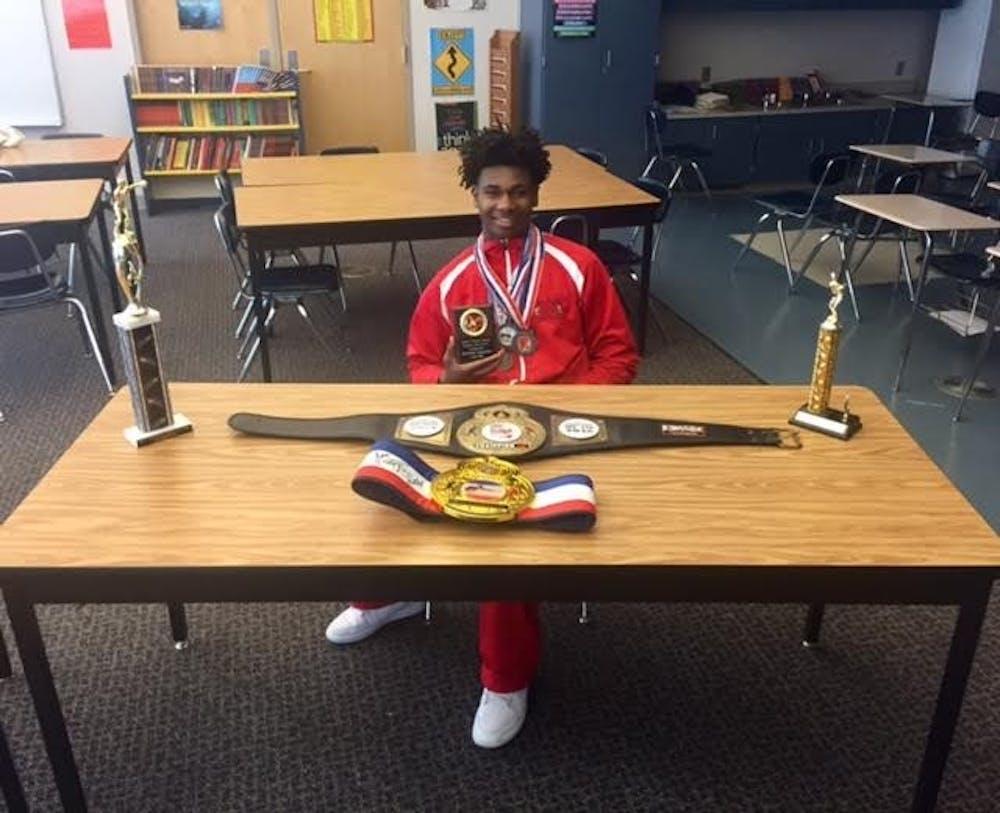 <p>Freshman Albert Ballard displays some of his awards from his boxing matches.</p>