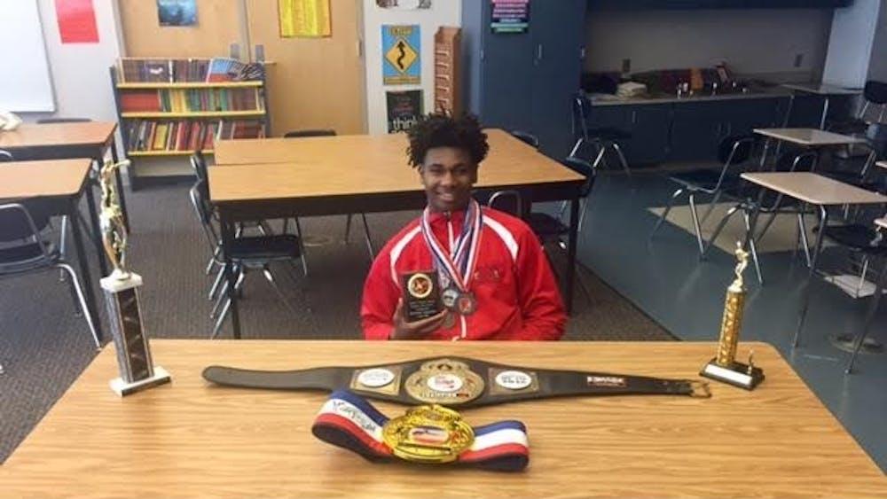Freshman Albert Ballard displays some of his awards from his boxing matches.