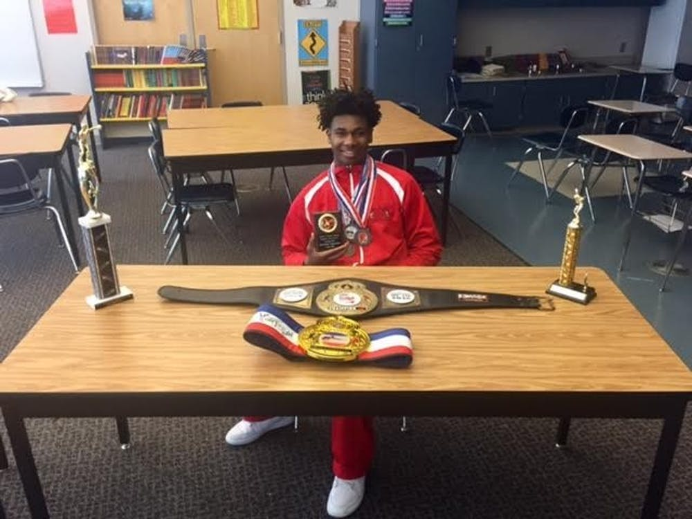 Freshman Albert Ballard displays some of his awards from his boxing matches.