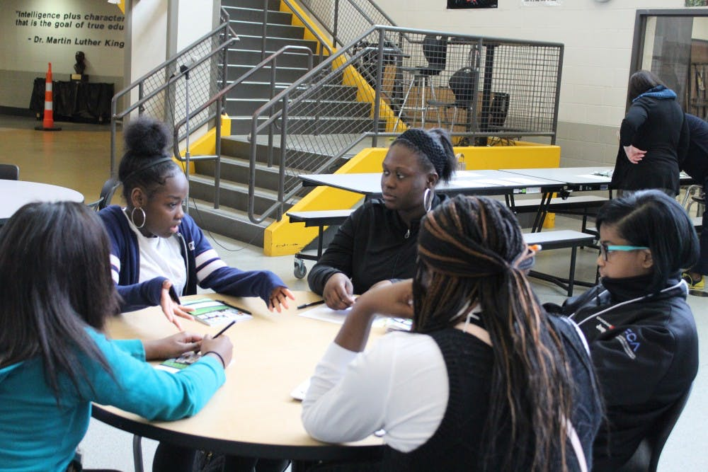 <p>Mentor Delana Bailey discusses how to deal with life challenges with her four ninth grade mentees.</p>