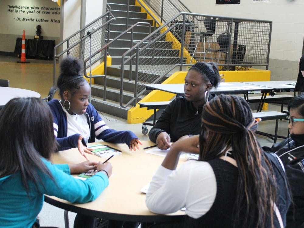 Mentor Delana Bailey discusses how to deal with life challenges with her four ninth grade mentees.