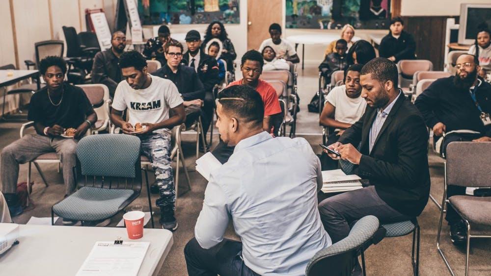 Esmat Ishag-Osman explains the political system to youth at the Matrix Center.