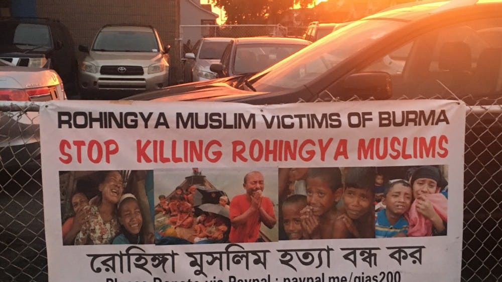 A multilingual sign in Hamtramck protests treatment of Rohingyas.