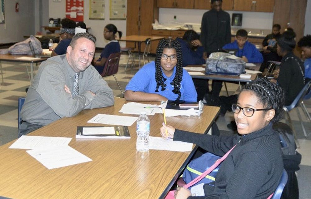 <p>&nbsp;Freshmen Ulyssia Jordan and Adrianna Holmes visit with Principal Sean Lively.</p>