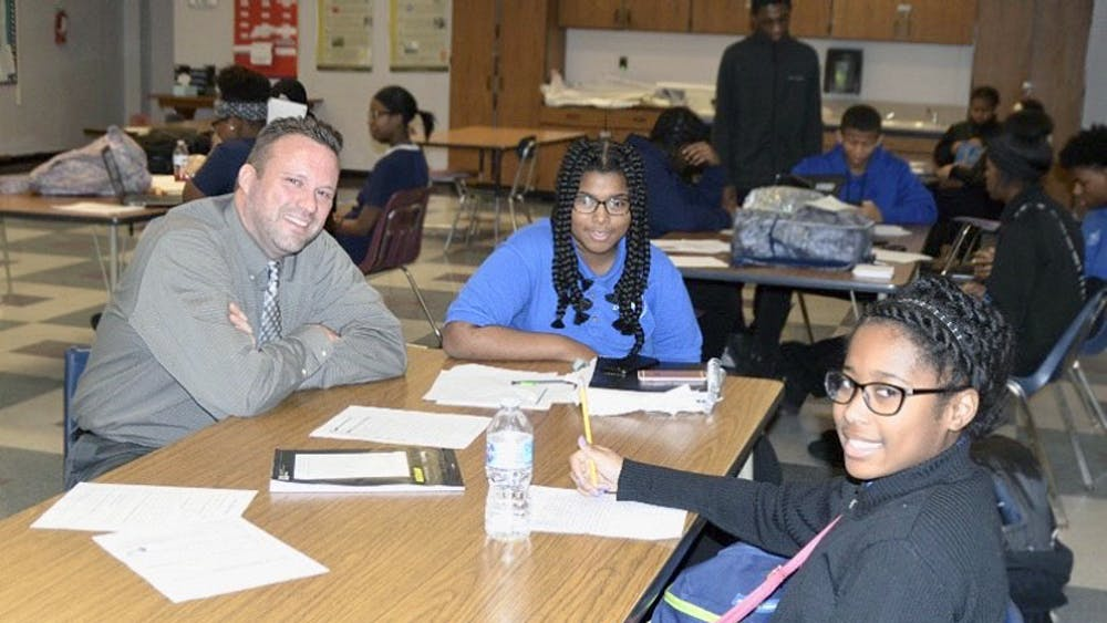 Freshmen Ulyssia Jordan and Adrianna Holmes visit with Principal Sean Lively.