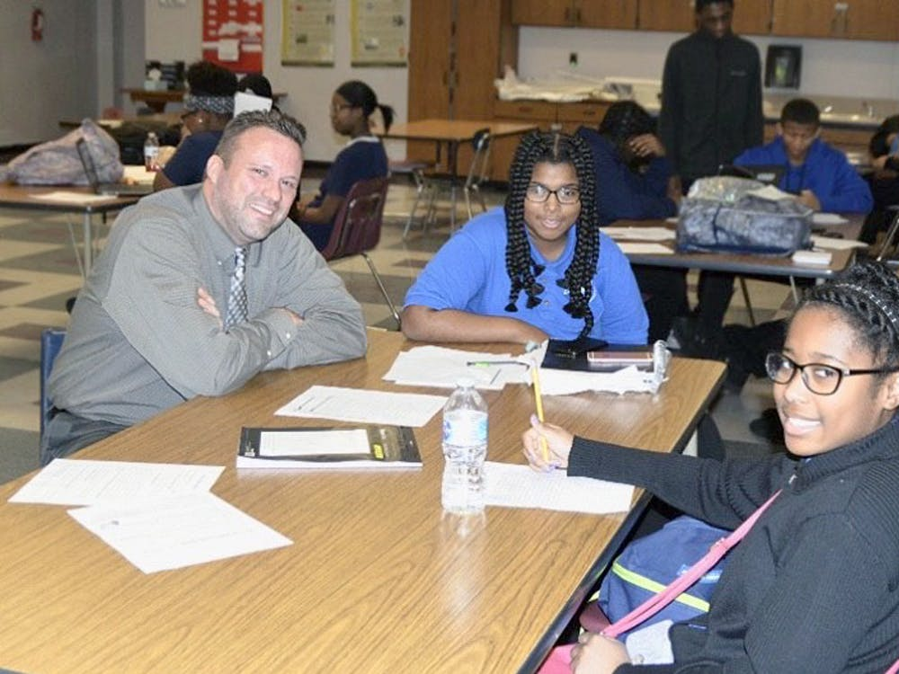 Freshmen Ulyssia Jordan and Adrianna Holmes visit with Principal Sean Lively.