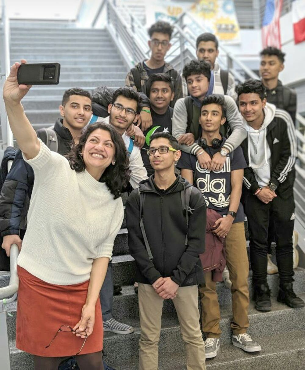 """<p>U.S. Rep. Rashida Tlaib, posing for a selfie with students, recently spoke at Cass Tech. """"She emphasized the significance of social justice and empowered the youth with her words of wisdom,"""" sophomore Muhammad Ali said.</p>"""