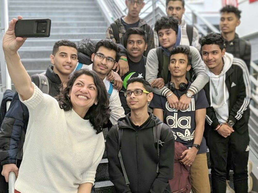 "U.S. Rep. Rashida Tlaib, posing for a selfie with students, recently spoke at Cass Tech. ""She emphasized the significance of social justice and empowered the youth with her words of wisdom,"" sophomore Muhammad Ali said."