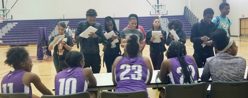 <p>Southeastern journalism students interview the girls basketball team as part of a Sports Media Day organized at the school.</p>
