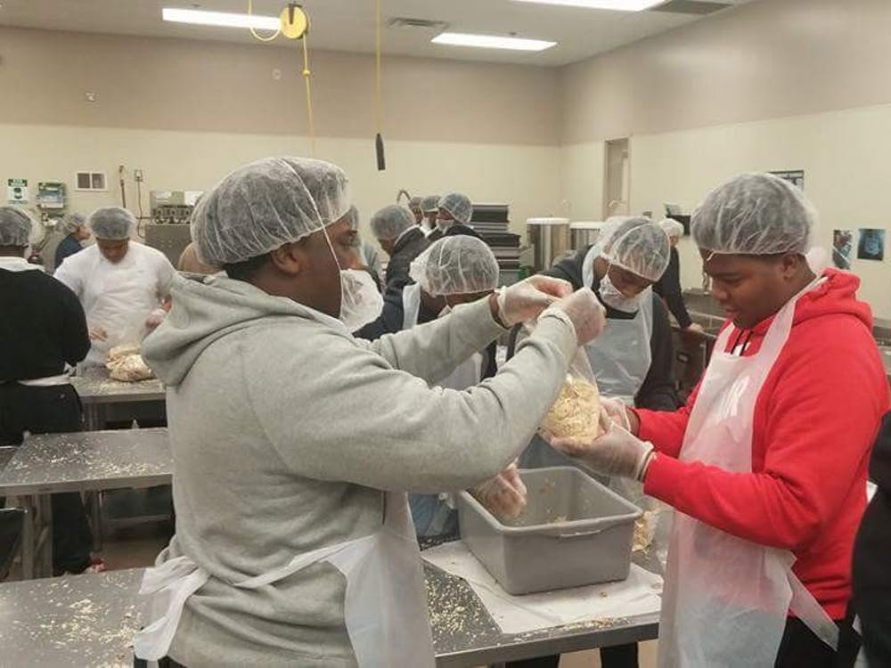 King's varsity football team goes to the Forgotten Harvest food pantry to lend a helping hand.