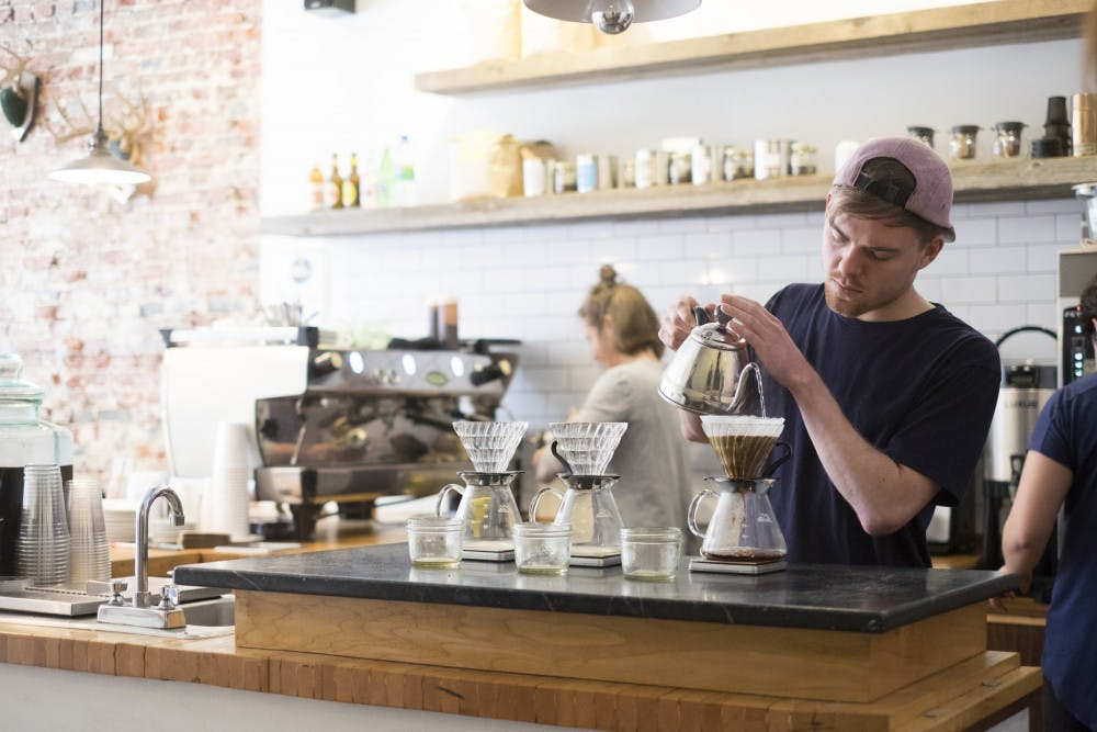 barista making pour over